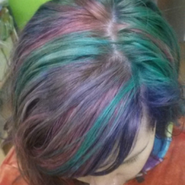 """Just a quick pic. The pastels didn't turn out as vibrant as I'd hope but they did turn out exactly like I expected from this brand and the shade I dyed over. I'll take some better pix when I get a few extra minutes. Ps I just left my hair air dry with only leave in conditioner in it. Hence the messy """"in need of some help"""" look lol (April 3rd)"""